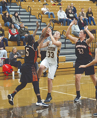 Western Brown's Bailie Darnall shoots over a Wilmington defender  in the Lady Broncos' season opener, Nov. 29.